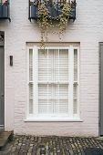 Nice Windows Or Balconies An Exclusive Mews With White Small Houses In Chelsea, A Wealthy Borough Of poster