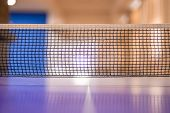 The Net Of The Ping Pong Table. The Net Is Placed In The Center Of The Table, Thus Dividing The Tabl poster