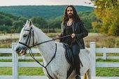 Handsome Rider Man On Horse. Equestrian Rides His White Well Looking Horse. Handsome Man Riding Hors poster