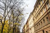 Facades In A Typical Street Of Zizkov District In Autumn, During A Cloudy Afternoon, With Its Tradit poster