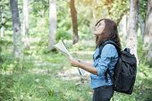 Woman Traveller Using Map In Green Natural Park Trekking Alone Happy, Carefree Enjoy Backpack Outdoo poster
