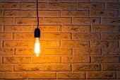 Vintage Fashionable Edison Lamp On Brick Background . Creative Idea Concept, Designer Lamp, Modern I poster