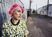 Woman With Pink Hair In An Alley