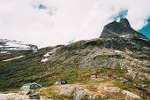 Trollstigen, Andalsnes, Norway. Wooden Houses In Mountains Landscape Near Road Trollstigen. Norwegia poster