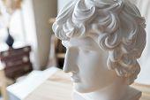 Renaissance Epoch. Gypsum Statue Of Apollos Head. Man. Statue. Isolated. Head. poster