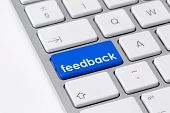 image of keyboard  - Photo of a computer keyboard with one blue button with the word feedback symbolising consumer responses - JPG