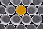 Orange Juice. Many Plastic Disposable Cups, One Is Filled With Orange Juice, Seen From Above. poster