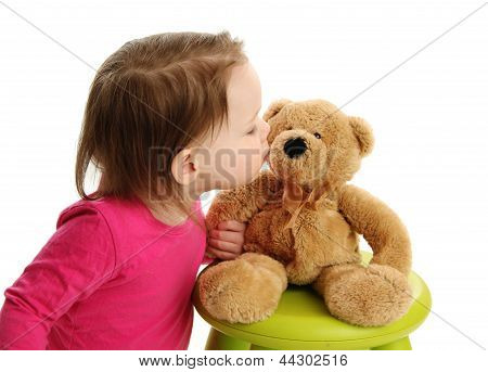 Little Toddler Girl Kissing A Teddy Bear