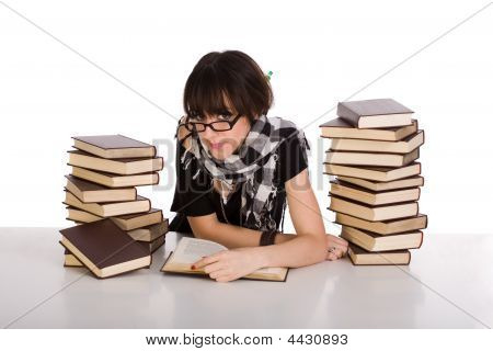 Learning And Reading Between Two Pile Of Books
