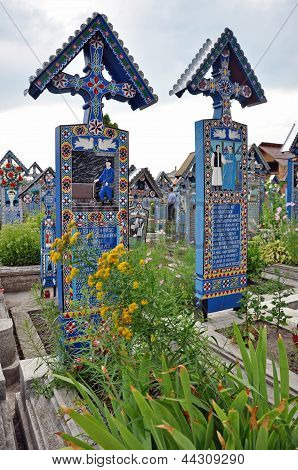 Painted wooden crosses in the Merry Cemetery. Unesco heritage site, Sapanta, Romania