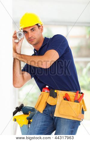 security surveillance system technician adjusting cctv camera