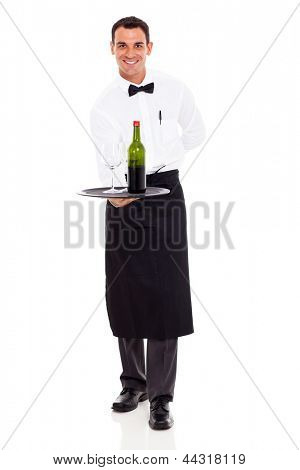 smiling restaurant sommelier holding tray of wine and glass