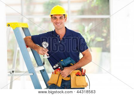 handsome cctv guy with tools and security camera