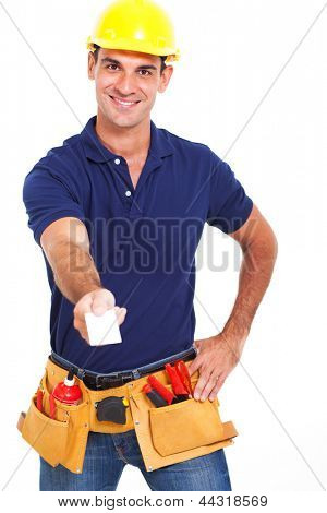 handsome handyman handing over his business card over white background