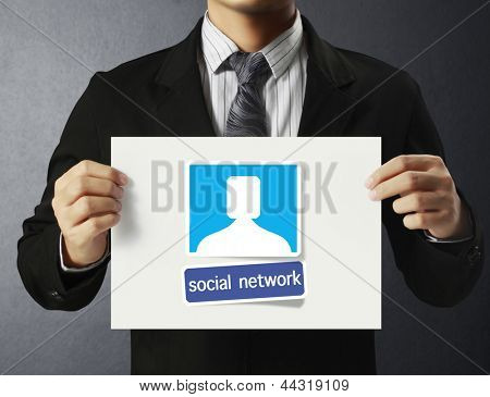 Business man handing social network business card over