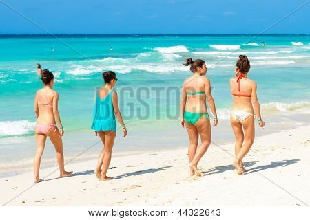 VARADERO,CUBA-APRIL 7:Young foreign tourists walking at the beach April 7,2013 in Varadero.With over a million visitors per year,Varadero is the main destination for tourists visiting the island