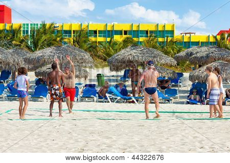 VARADERO,CUBA-APRIL 7:Tourists playing volleyball at Barcelo Solymar Hotel April 7,2013 in Varadero.With over 1 million visitors in 2012,Varadero is the main destination for tourists visiting Cuba