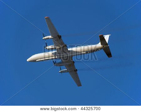 The plane. Russian turboprop passenger aircraft IL-18 in flight.