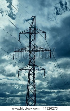 High-tension power line with dark clouds