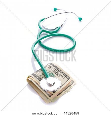 Doctor stethoscope with cash in dollars over white
