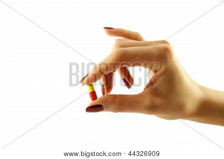 hand with a pill