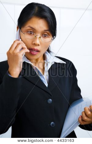 Businesswoman Is Very Serious On Phone