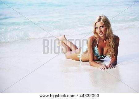 woman lying on the sand the ocean coast