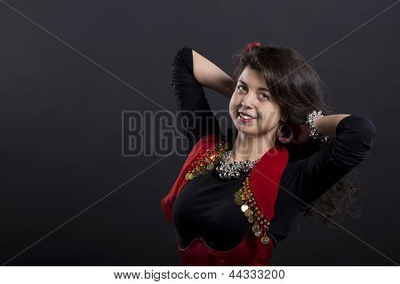Young Romany Woman Adjust Her Long Dark Hairs
