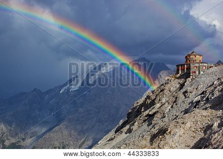 Alps high mountains and rainbow.