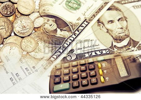 Calculator and American coins banknotes.
