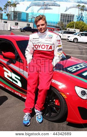LOS ANGELES - APR 9:  Brett Davern at the Toyota ProCeleb Race Press Day 2013 at the Toyoto Grand Prix Circuit on April 9, 2013 in Long Beach, CA