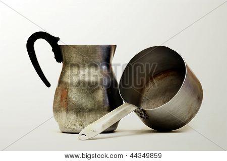 A metal jug and  saucepan