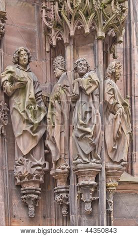 Sculpture Of St Laurent With Followers. Strasbourg Cathedral