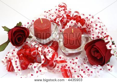 Pair Of Unlit Red Candles, With Ribbon And Roses.