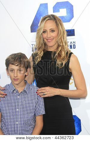 LOS ANGELES - APR 9: Kim Raver, son Luke Boyer at the Los Angeles Premiere of '42' at TCL Chinese Theater on April 9, 2013 in Los Angeles, California