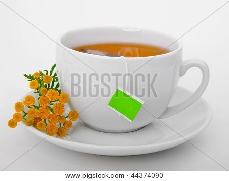 Green Tea With Tea Bag And Herb Flower.