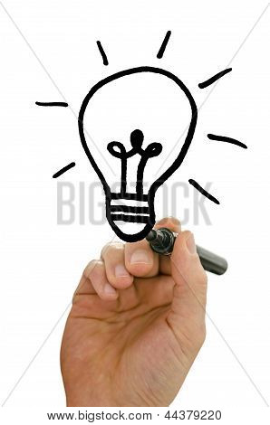 Male Hand Drawing Light Bulb On Virtual Screen