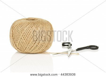 Ball Of Natural String With Loose End And Scissors On White Background With Reflection