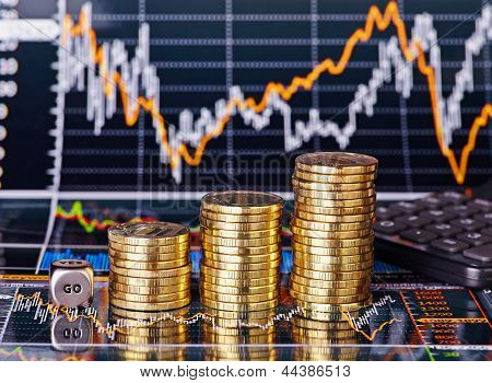 Uptrend Stacks Coins, Dices Cube With The Word Go And Calculator On The Financial Stock Charts As Ba