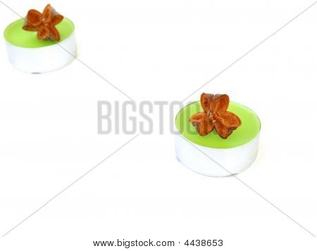 Close Up Shot Of Green Candle And Dried Fruit