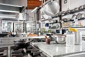stock photo of saucepan  - Variety of utensils on counter in commercial kitchen - JPG