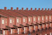 stock photo of urbanisation  - Row of red residential houses in a urbanization in Spain - JPG