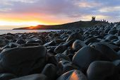 Sunrise Over Dunstanburgh Castle