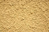 A Yellow Stucco Wall Useful For Backgrounds Or Textures