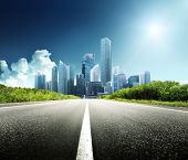 stock photo of freedom tower  - Asphalt road and modern city - JPG