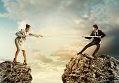 picture of rope pulling  - Confrontation between two business people - JPG
