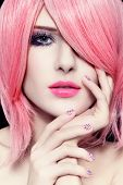 stock photo of manga  - Portrait of young beautiful woman with fancy haircut and trendy caviar manicure - JPG
