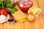 Lasagna ingredients on wooden background