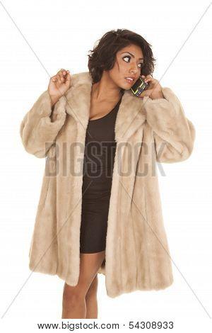 Hispanic Woman Fur Coat Phone Look Back