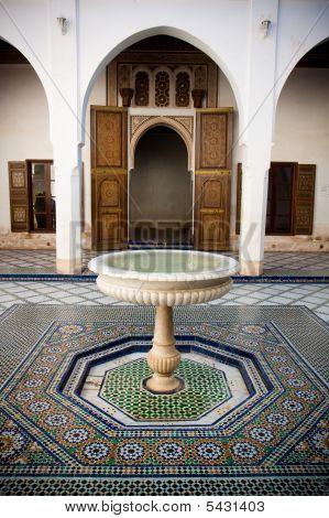 Moroccan Mosaic Floor And Wooden Door